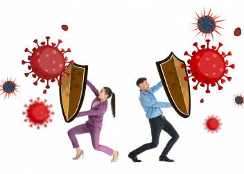 Muž a žena se brání proti virům a bakteriím
